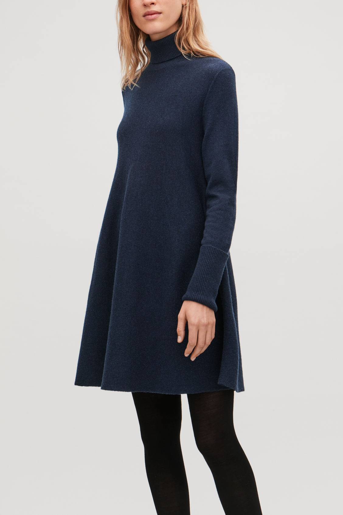 Model side image of Cos lambswool knit a-line dress in blue
