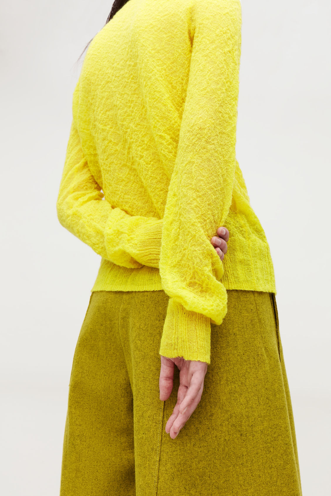 Model side image of Cos crinkled rib-knit top  in yellow