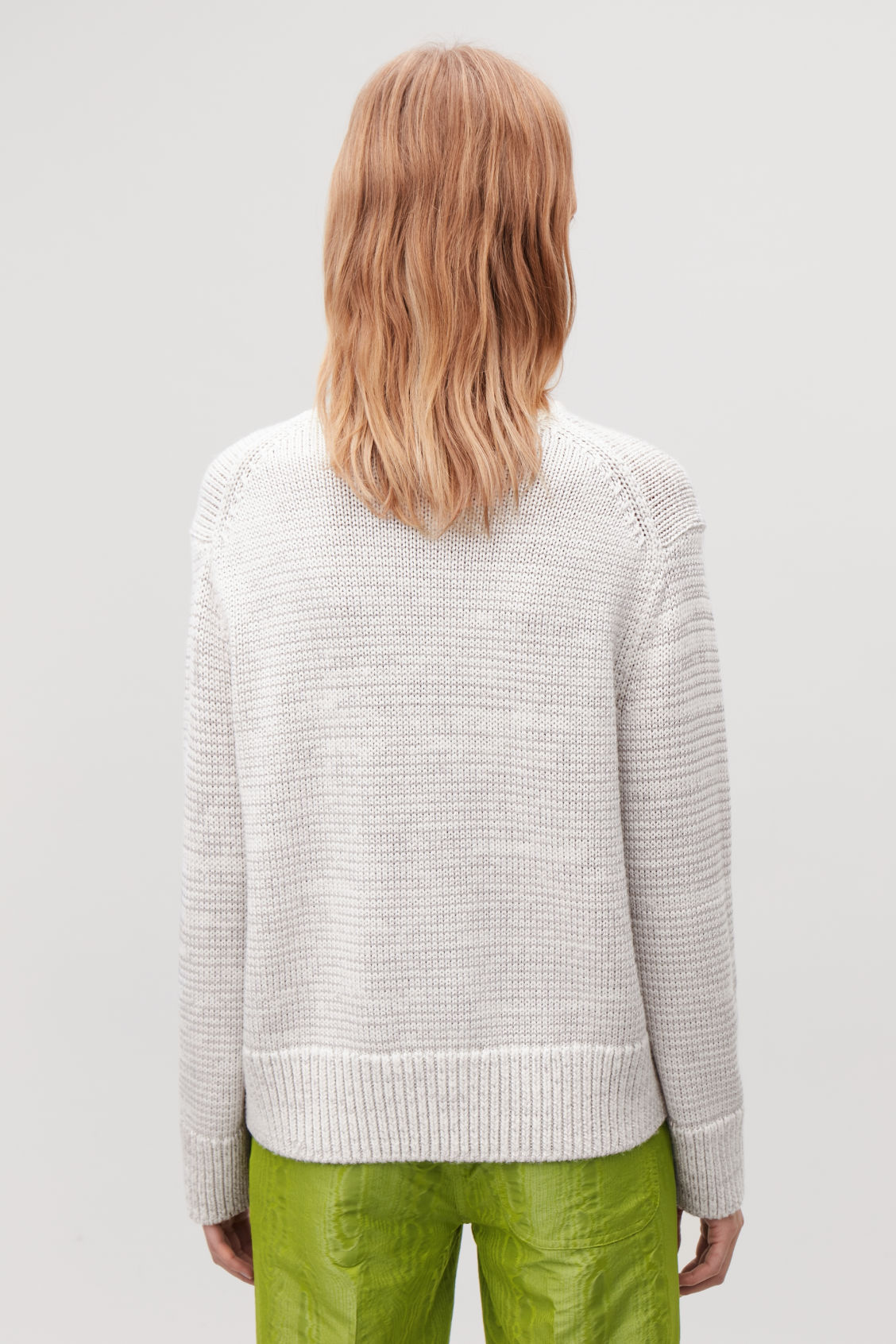 Model side image of Cos chunky-knit wool jumper in neutral