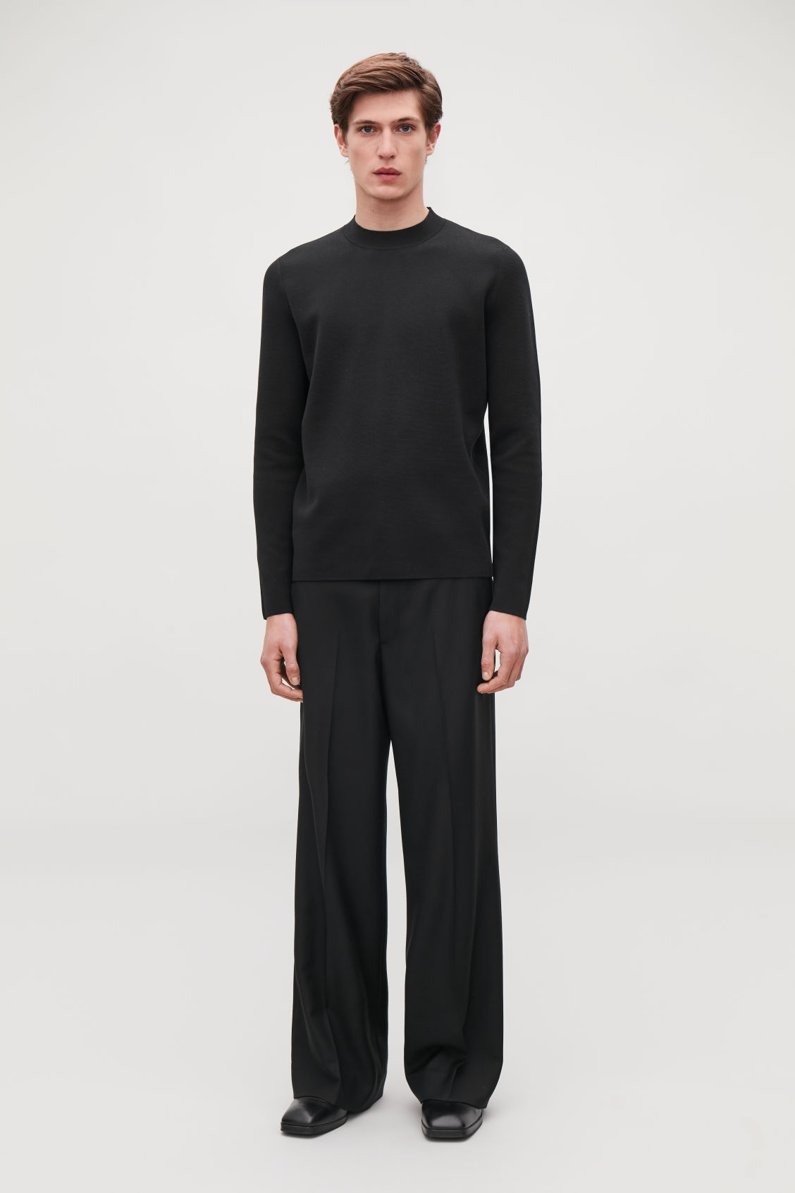 Model front image of Cos mock-neck knitted jumper in black