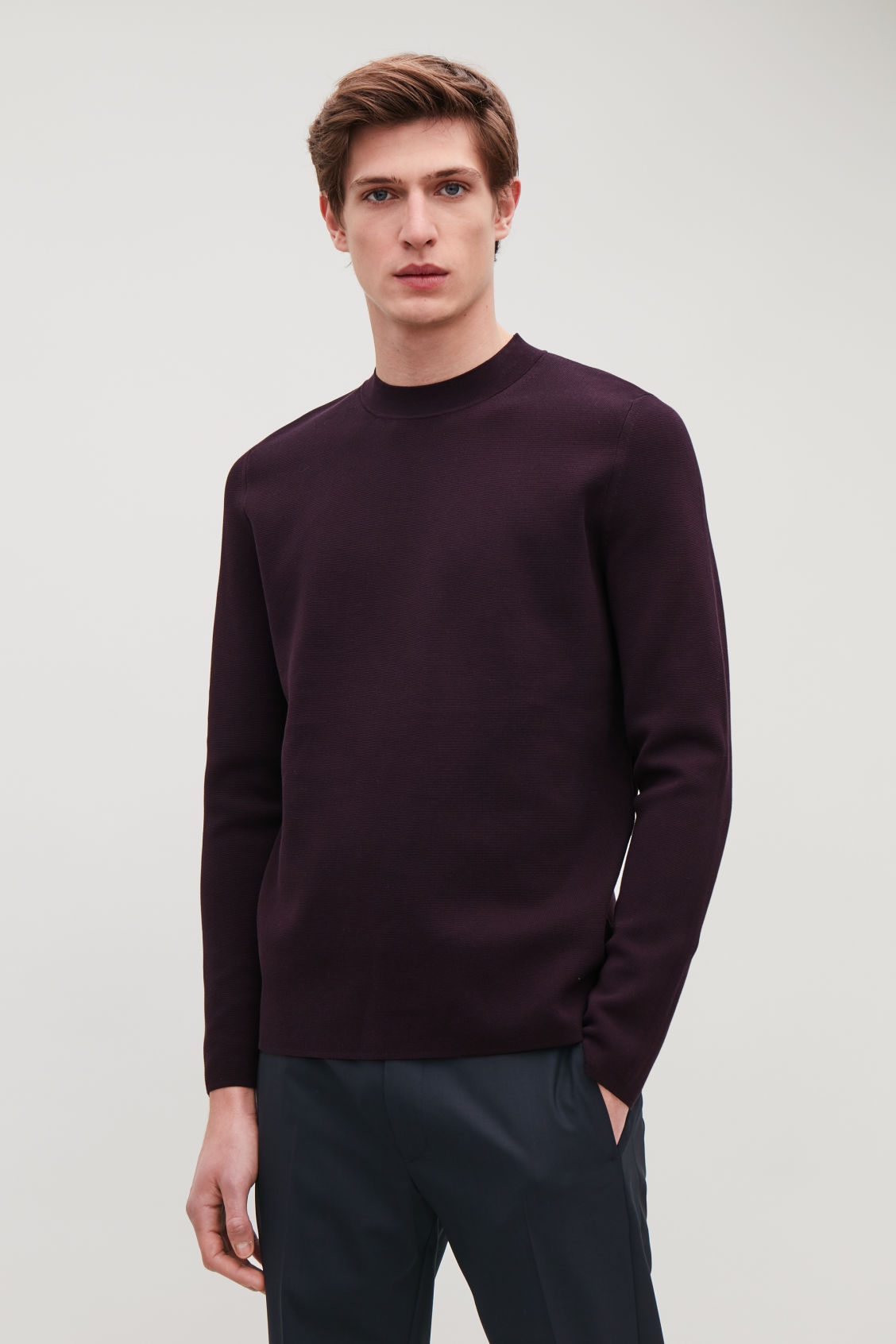 Model side image of Cos mock-neck knitted jumper in purple