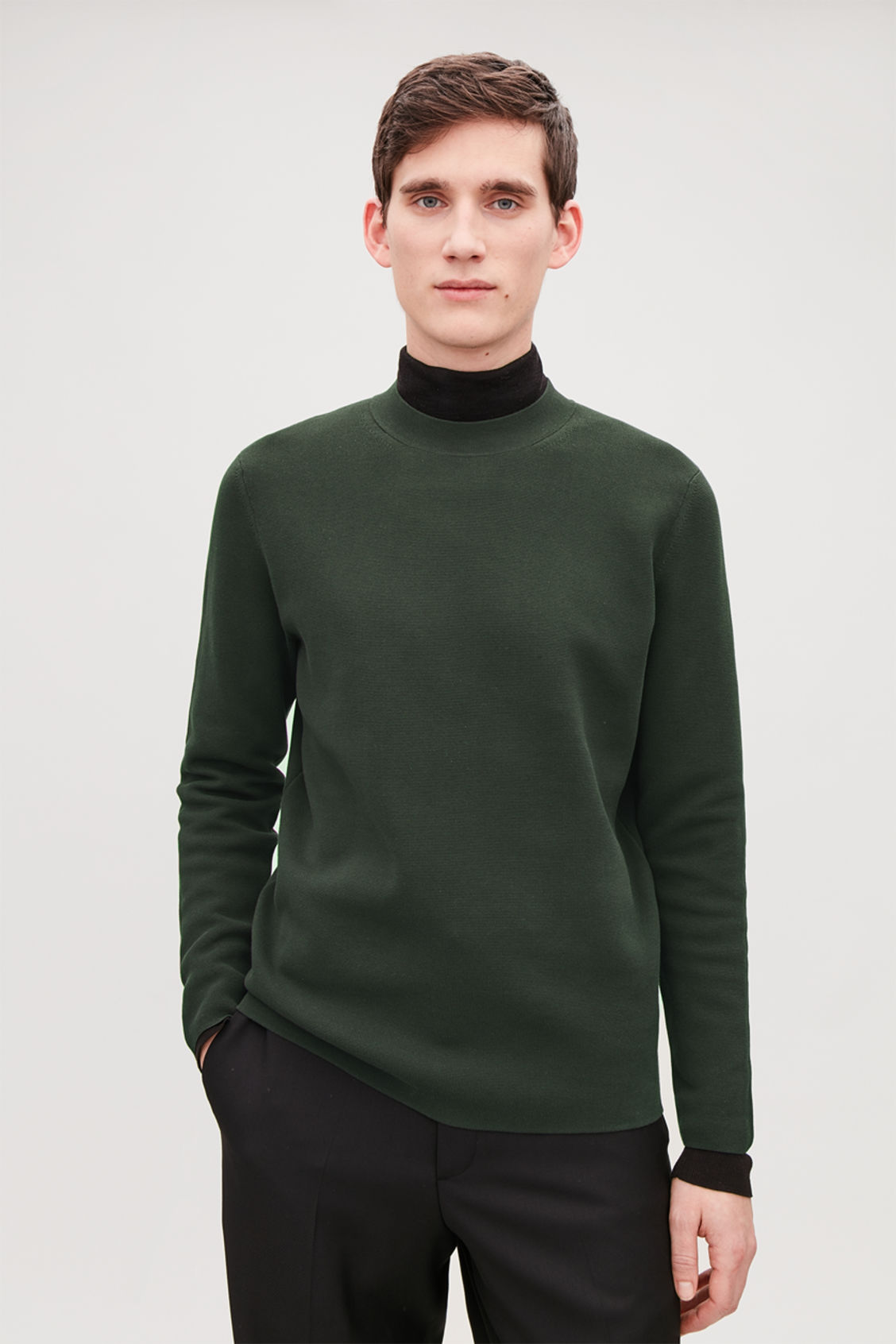Model side image of Cos mock-neck knitted jumper in green