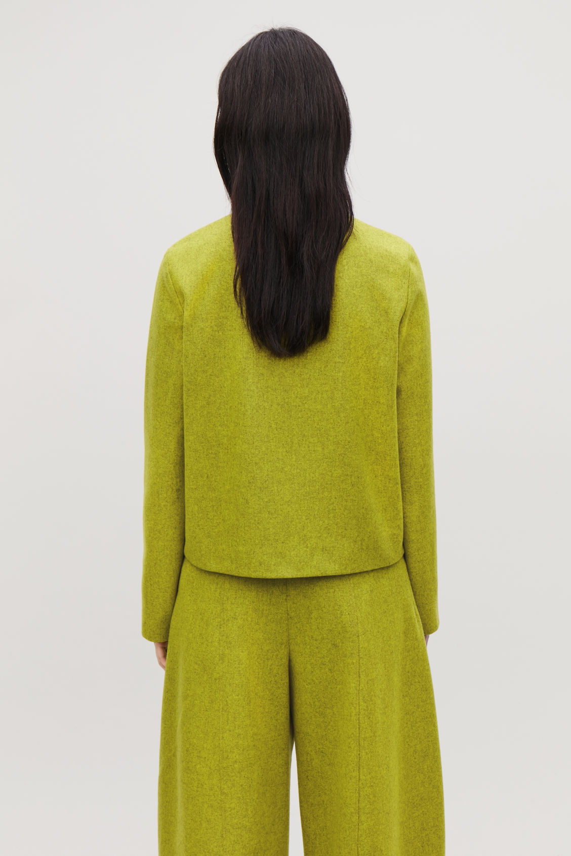 Model side image of Cos deep v-neck wool top in yellow