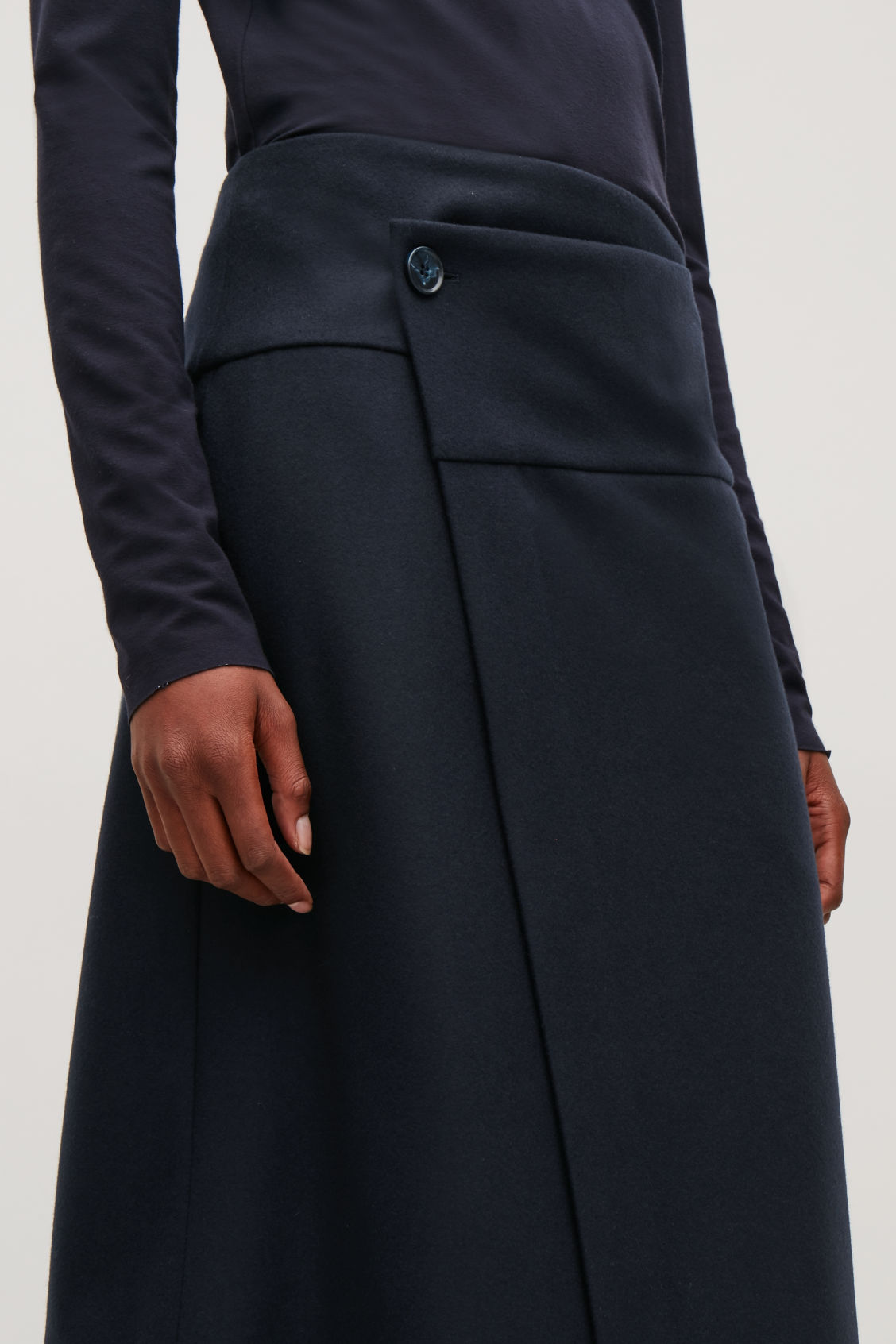 Model side image of Cos a-line wrap skirt in blue