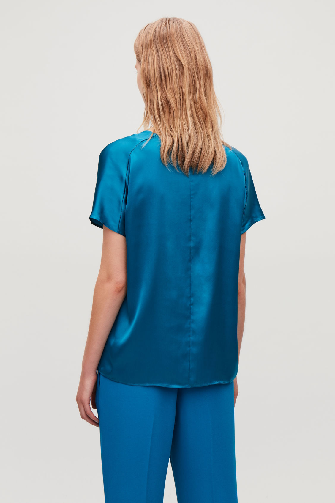 Model side image of Cos boxy silk top in turquoise