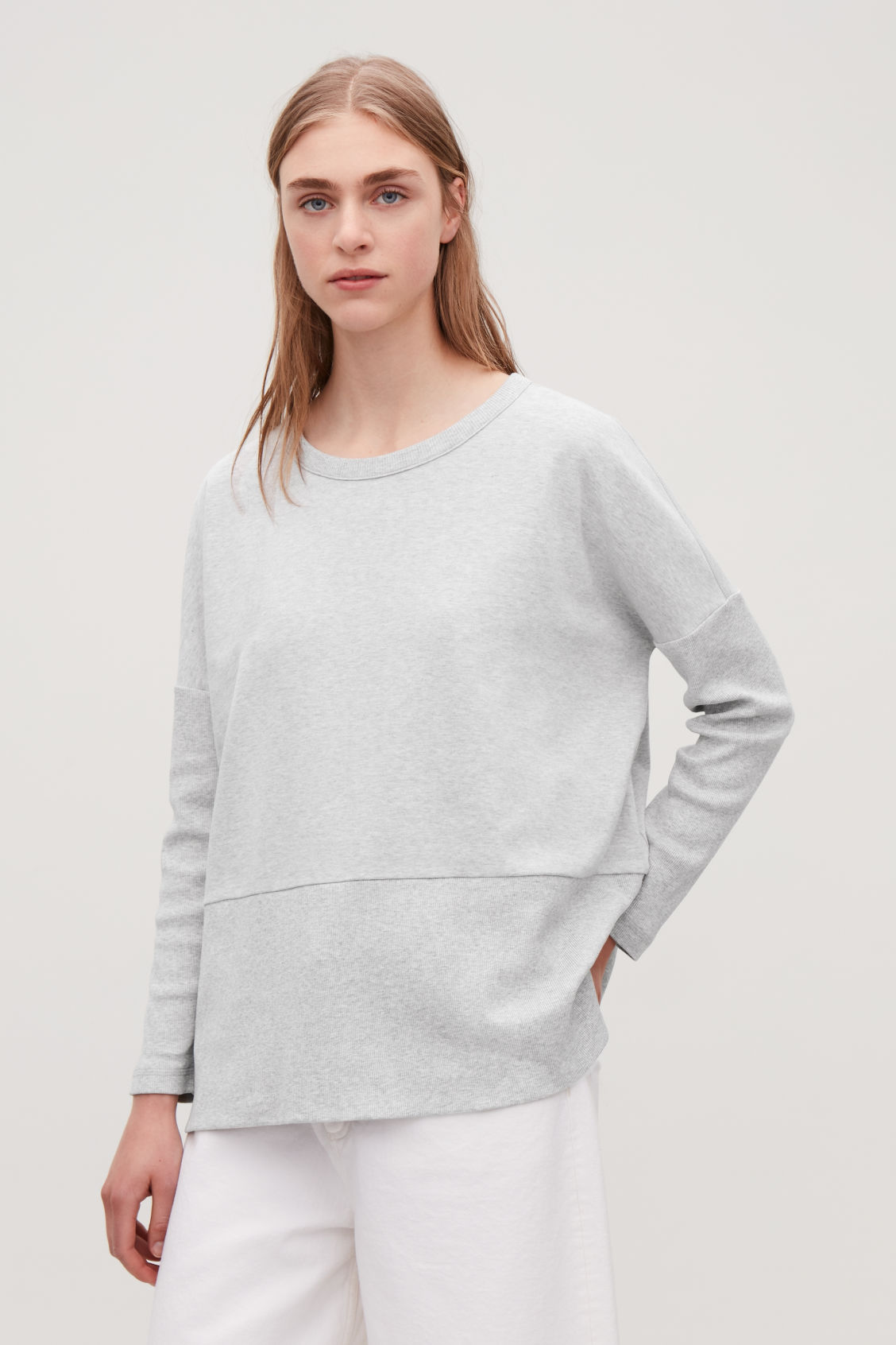 Model side image of Cos cocoon ribbed-jersey top in grey