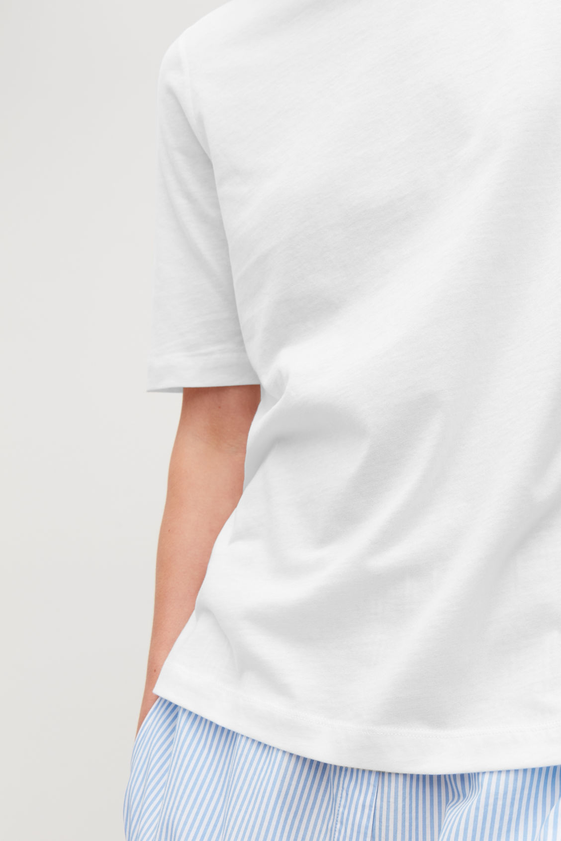 Model side image of Cos soft cotton t-shirt  in white