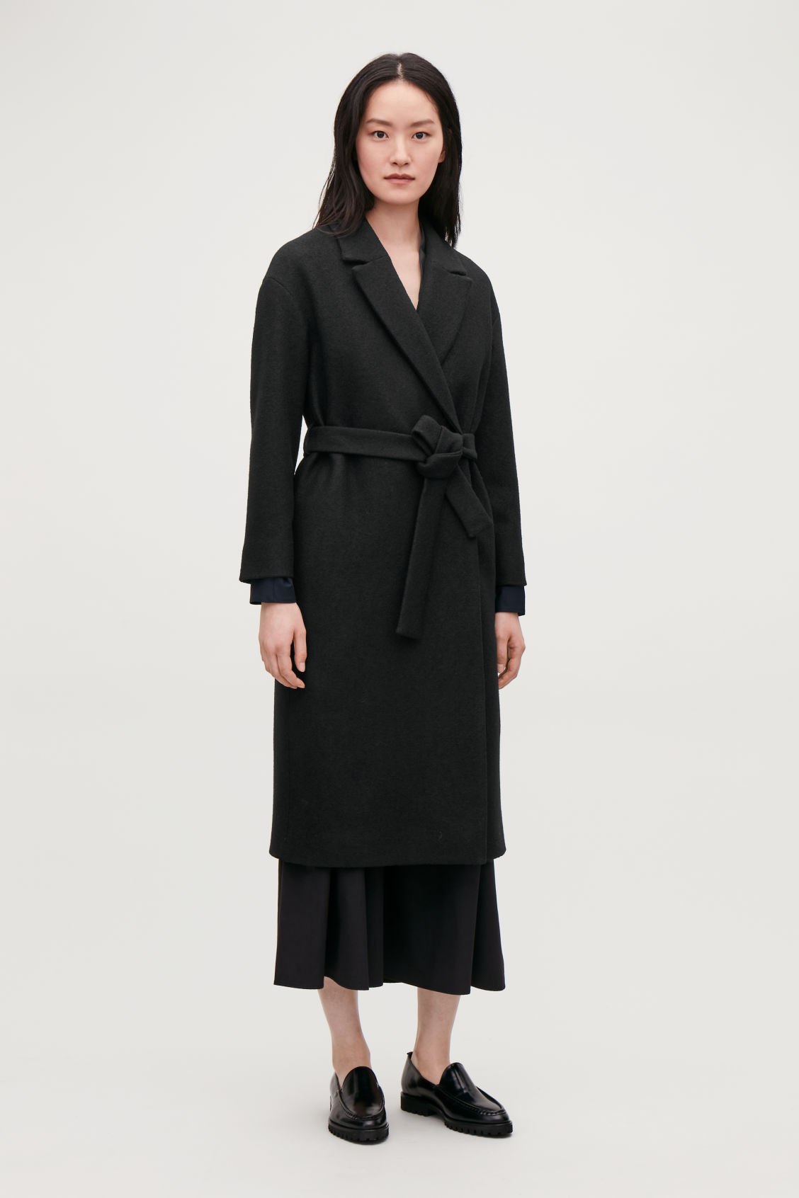 Model front image of Cos belted wool coat in black