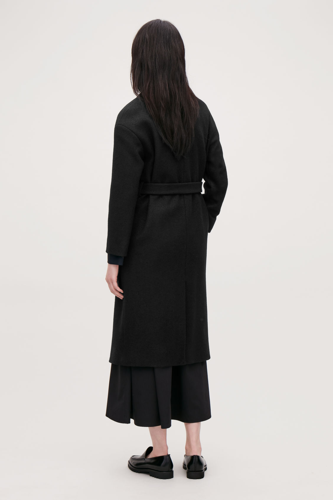 Model side image of Cos belted wool coat in black