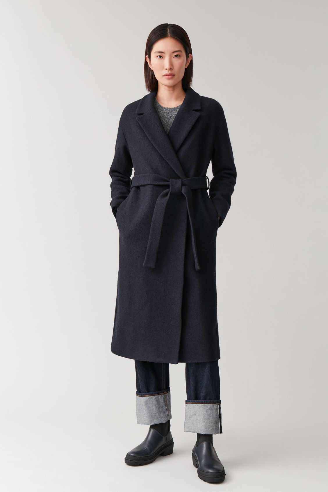 Model front image of Cos belted wool coat in blue