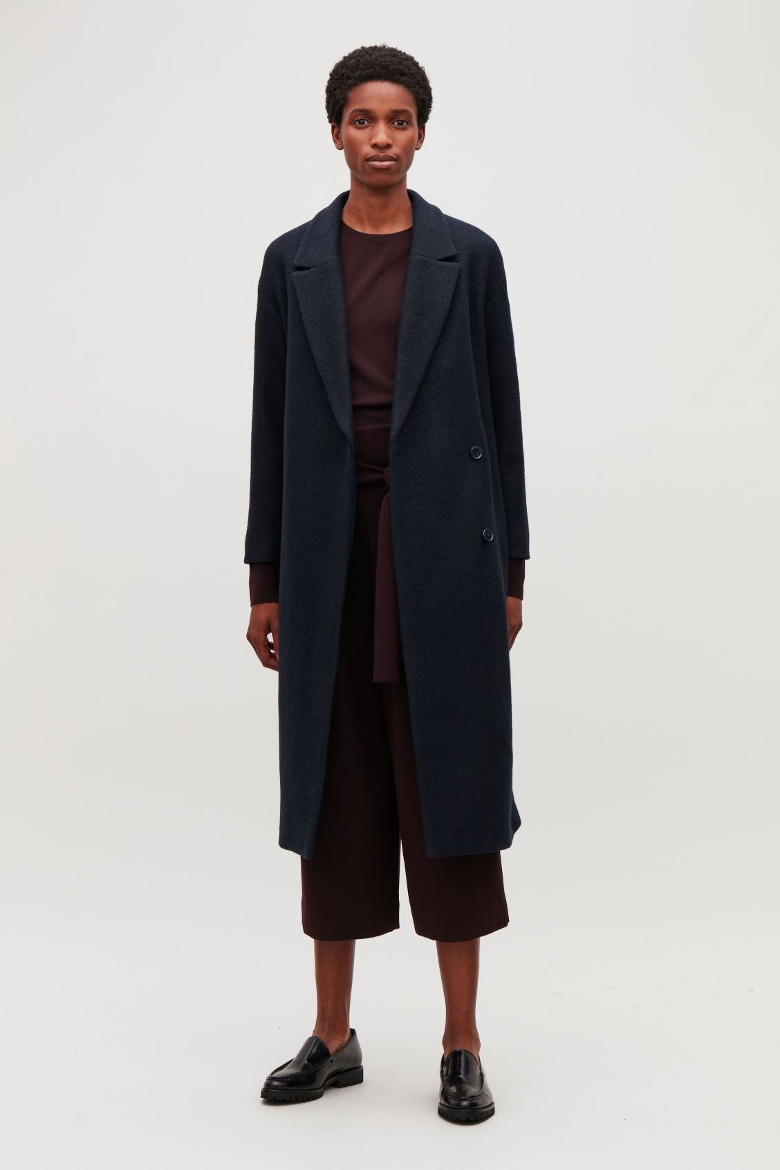 Model side image of Cos belted wool coat in blue