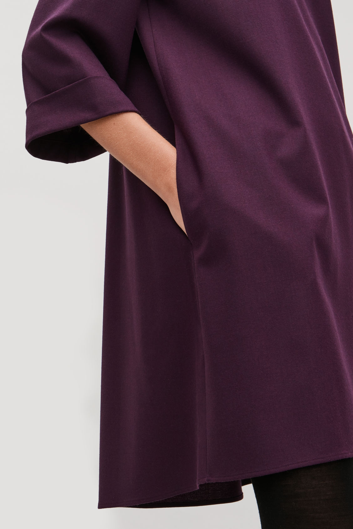 Model side image of Cos wool dress with turn-up cuffs  in purple