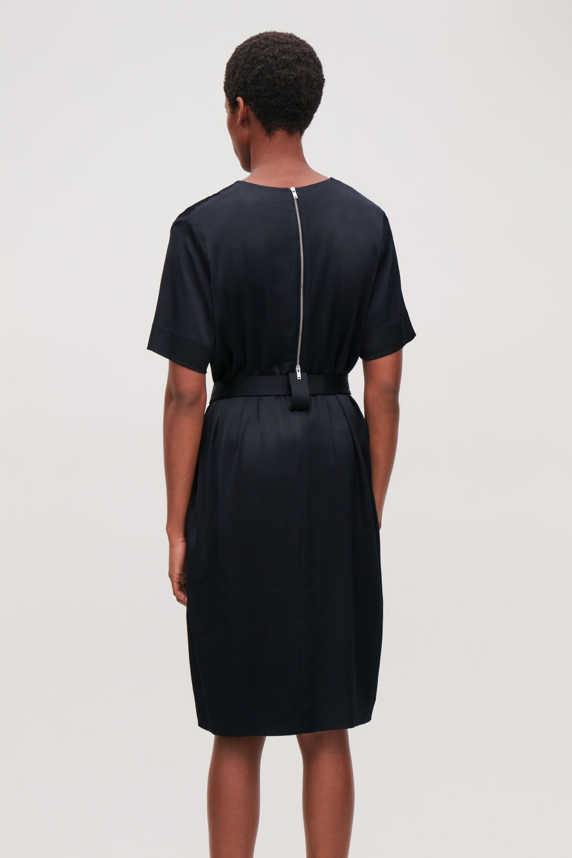 Model side image of Cos v-neck dress with belt in blue