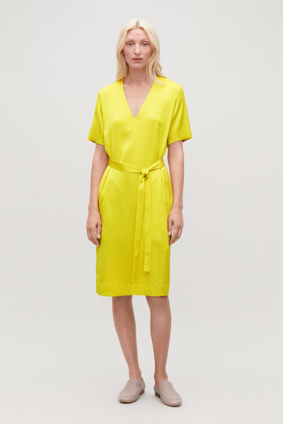 Model front image of Cos v-neck dress with belt in yellow