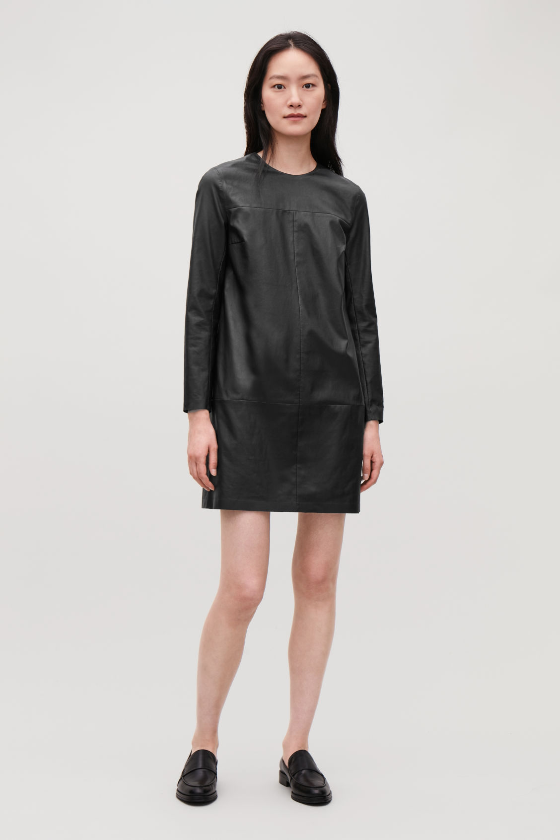 Model front image of Cos long-sleeved leather dress in black