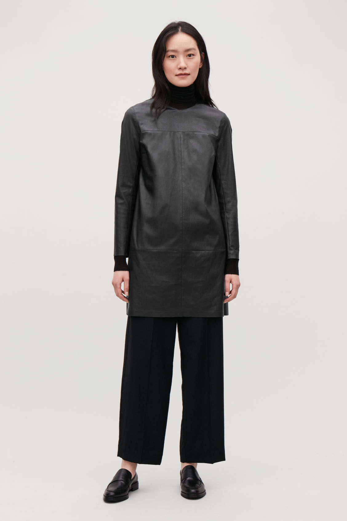 Model side image of Cos long-sleeved leather dress in black