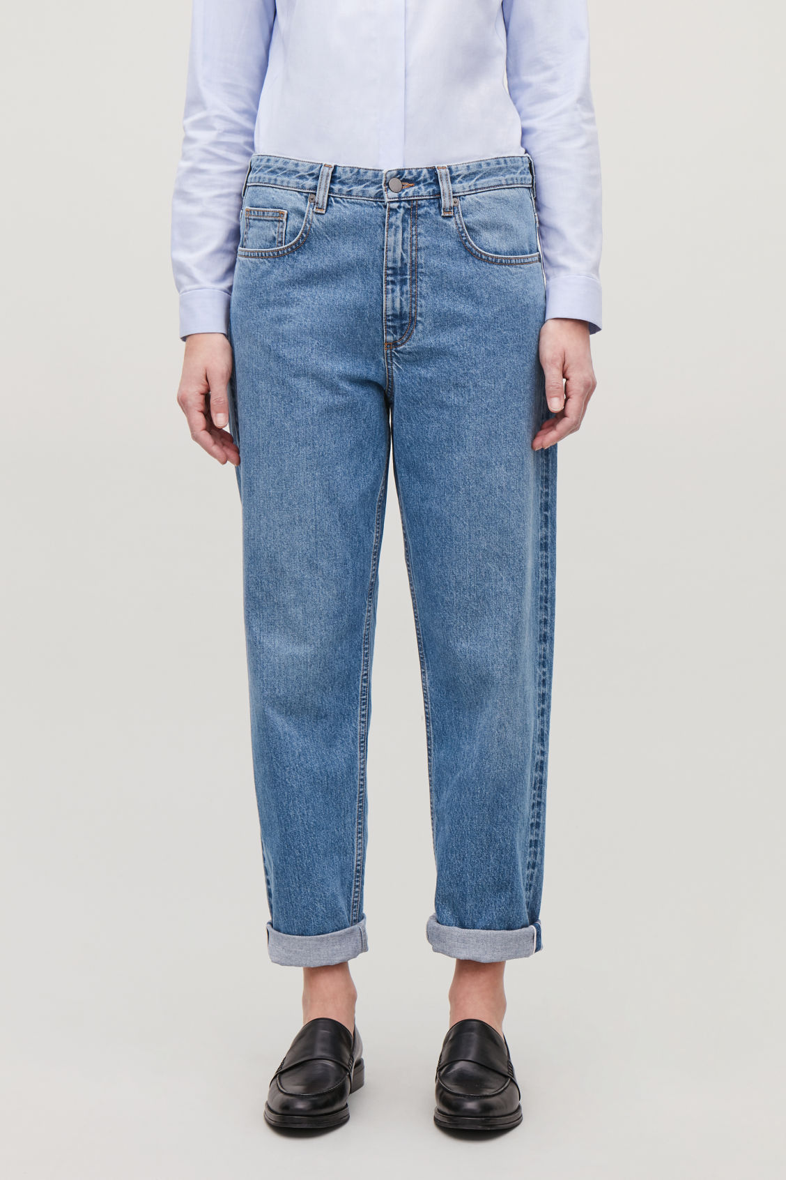 Model side image of Cos selvedge straight-leg jeans in blue