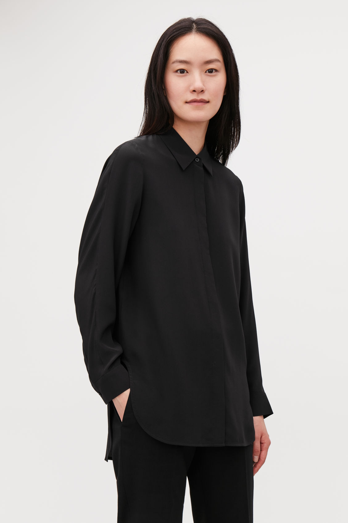 Model side image of Cos long cocoon silk shirt in black