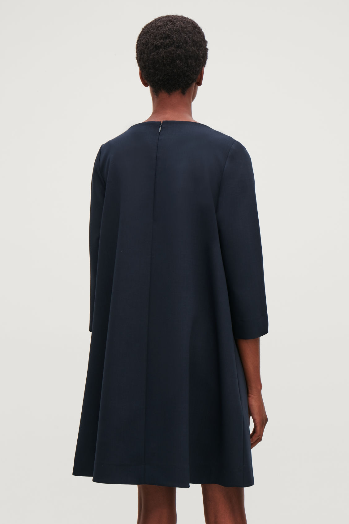 Model side image of Cos wide-neck a-line wool dress in blue