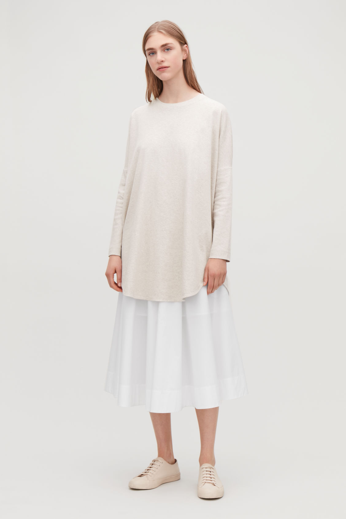 Model front image of Cos cocoon jersey top in beige