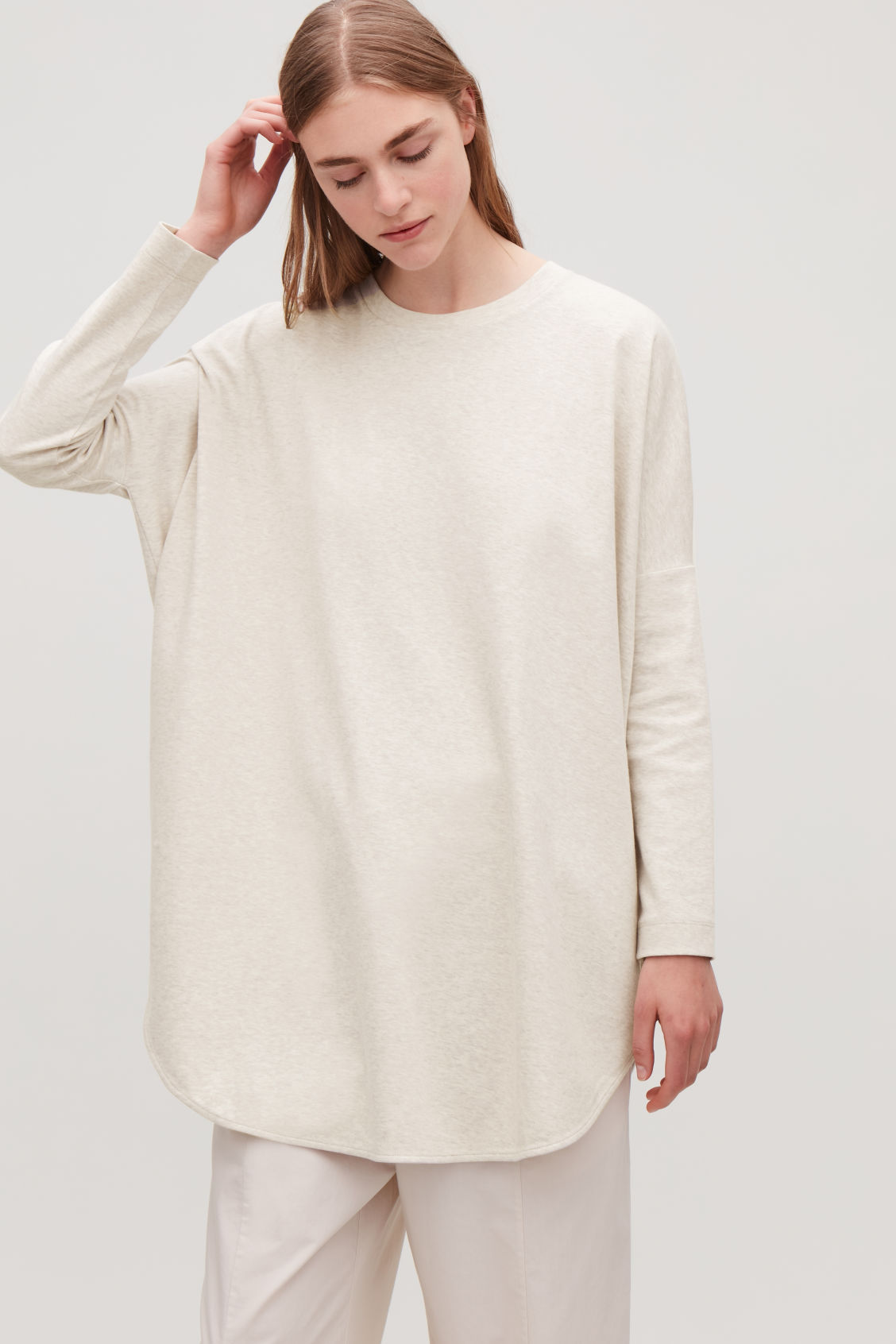 Model side image of Cos cocoon jersey top in beige