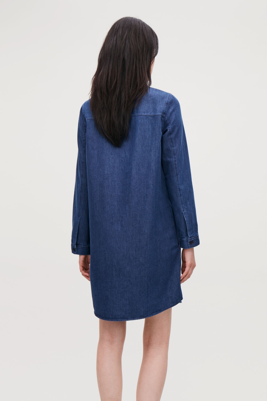 Model side image of Cos a-line denim shirt dres in blue