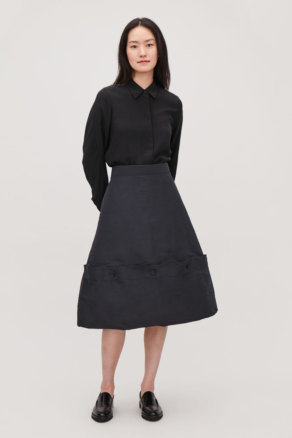 Model front image of Cos draped skirt with buttons in blue