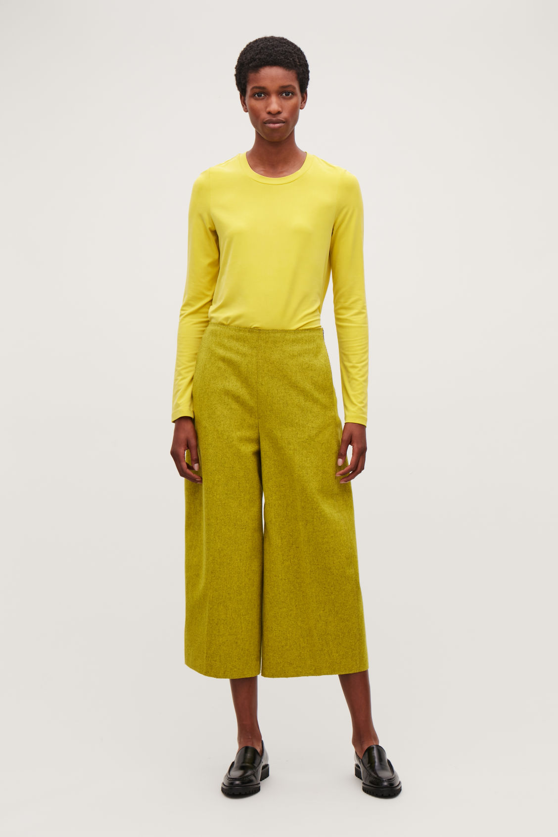 Model front image of Cos slim-fit long-sleeved top in yellow