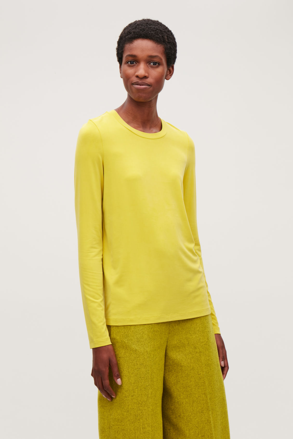 Model side image of Cos slim-fit long-sleeved top in yellow
