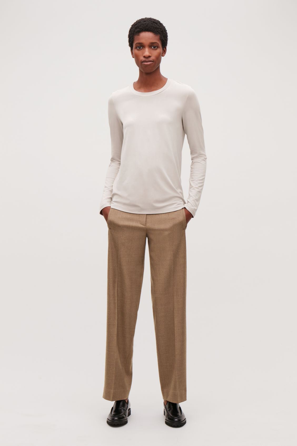 Model front image of Cos slim-fit long-sleeved top in brown
