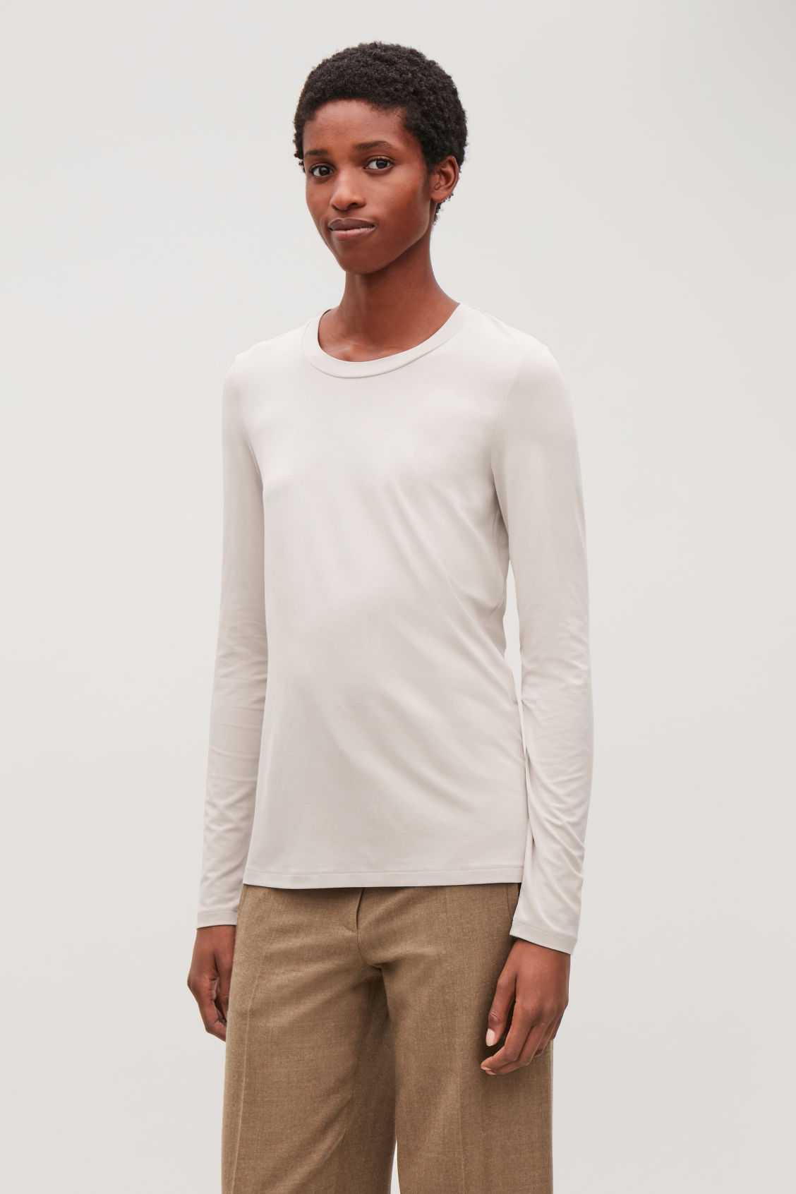 Model side image of Cos slim-fit long-sleeved top in brown