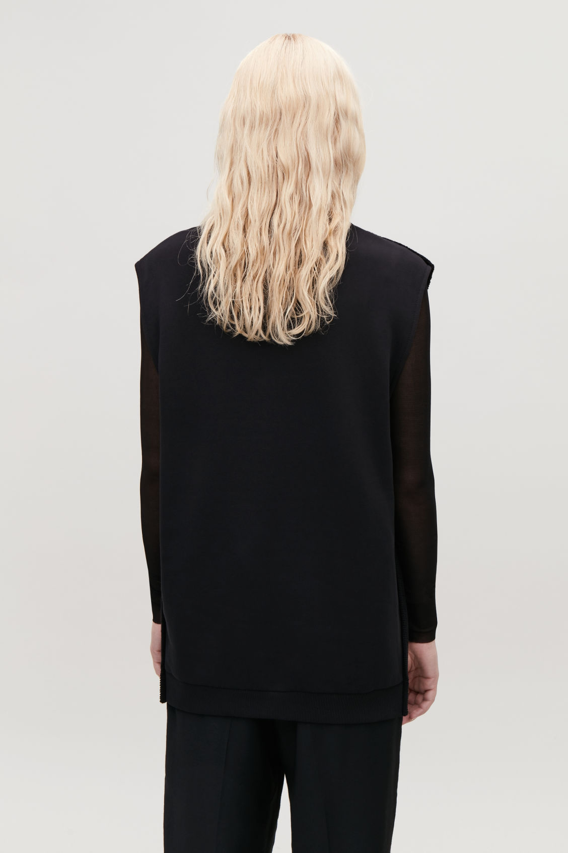 Model side image of Cos knit-jersey sleeveless top in black