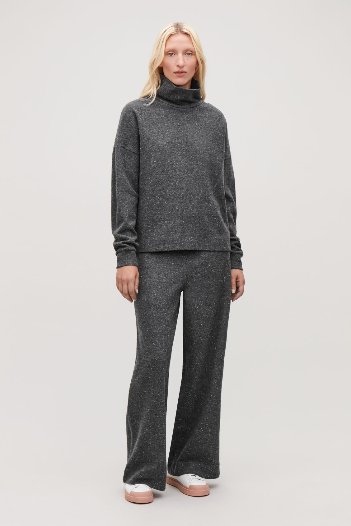 Model front image of Cos speckled high-neck top in grey