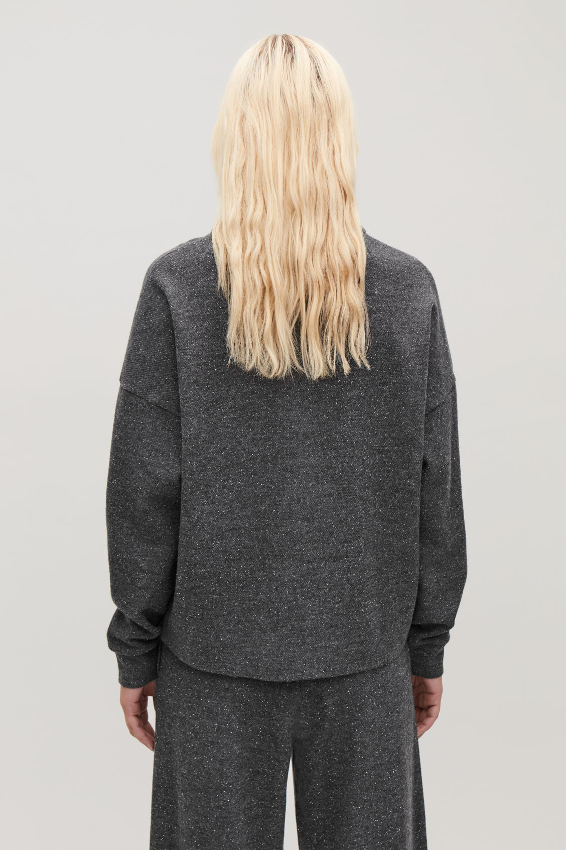 Model side image of Cos speckled high-neck top in grey