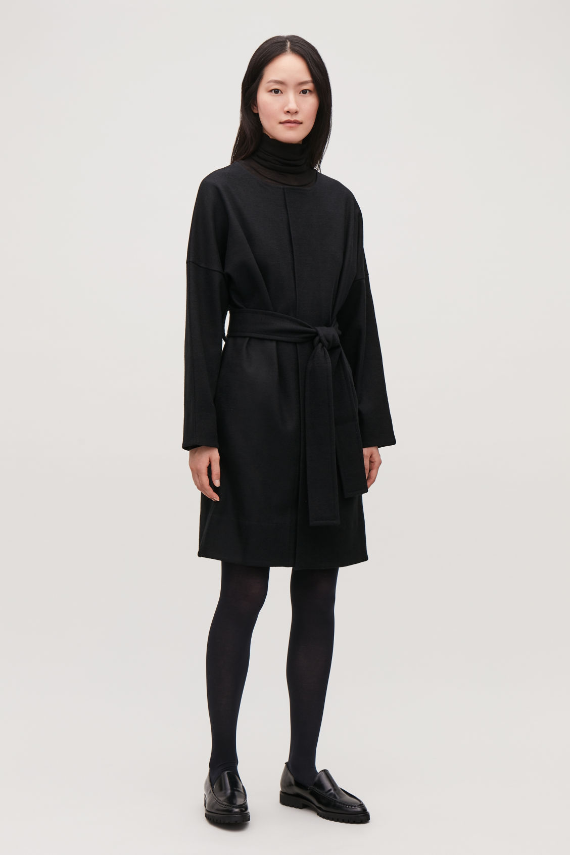 Model front image of Cos belted wool wrap dress in black