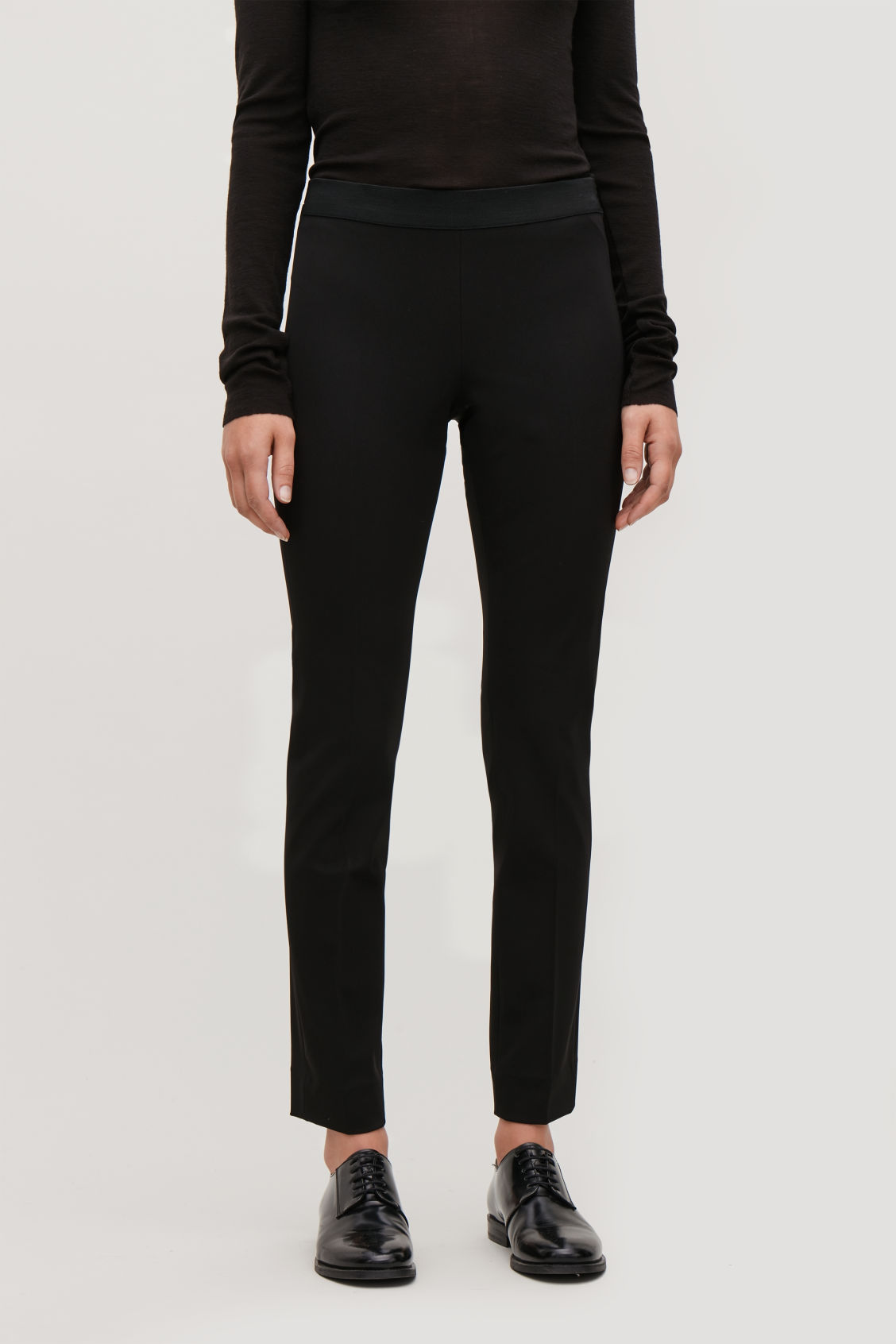 Model side image of Cos elastic-waist stretch trousers in black