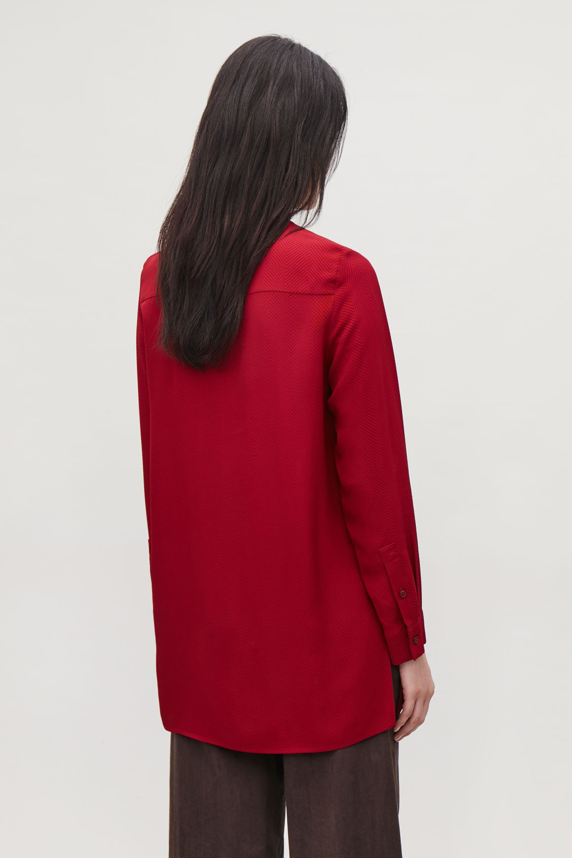 Model side image of Cos loose chevron-patterned blouse in red