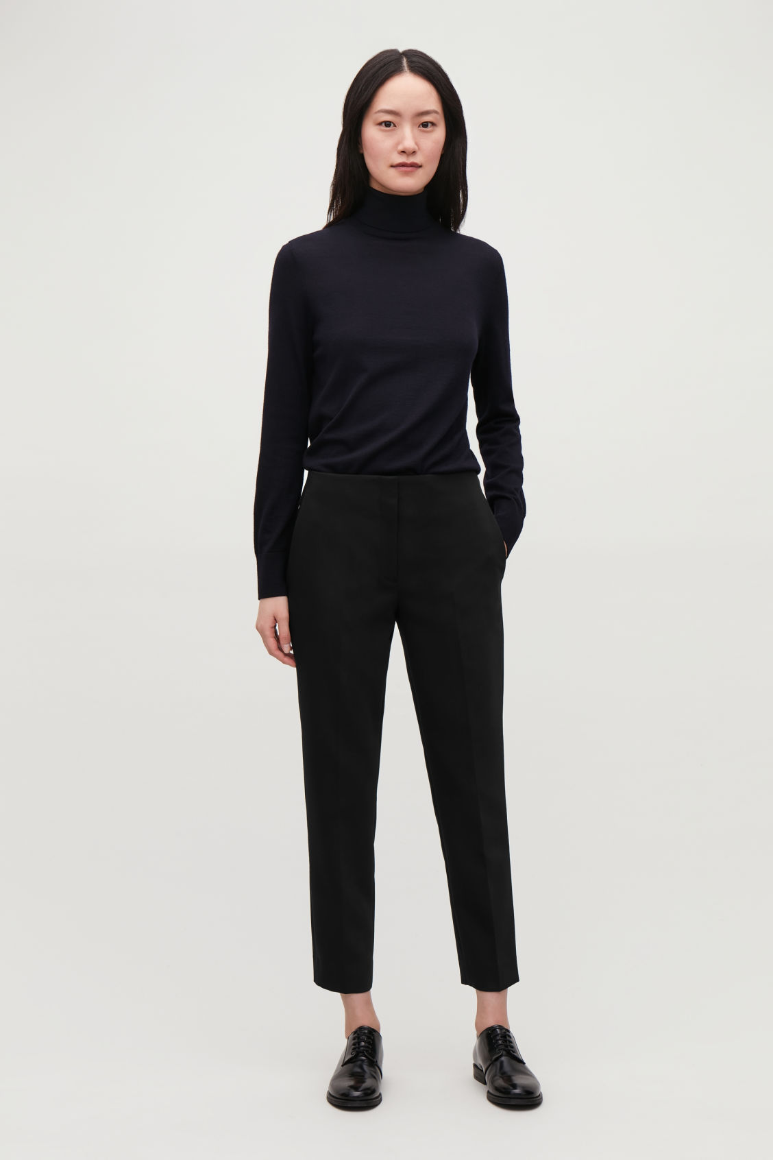 Model front image of Cos stretch-wool tailored trousers  in black