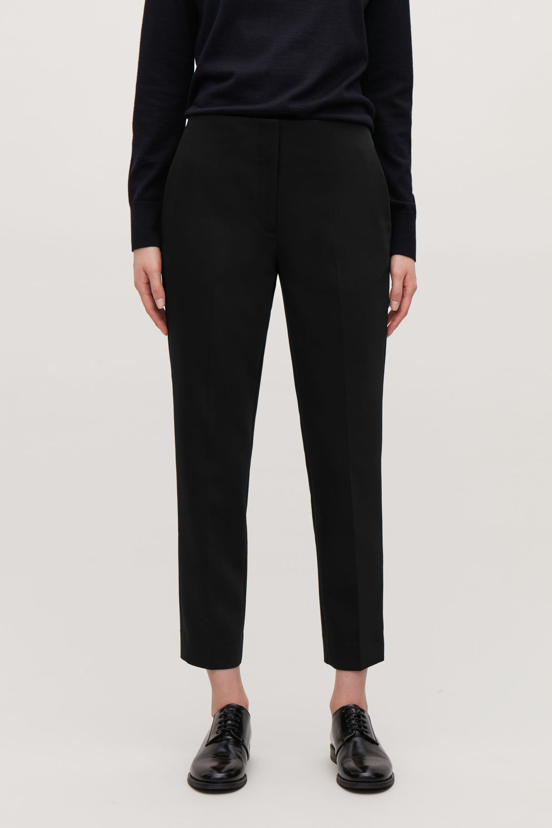 Model side image of Cos stretch-wool tailored trousers  in black