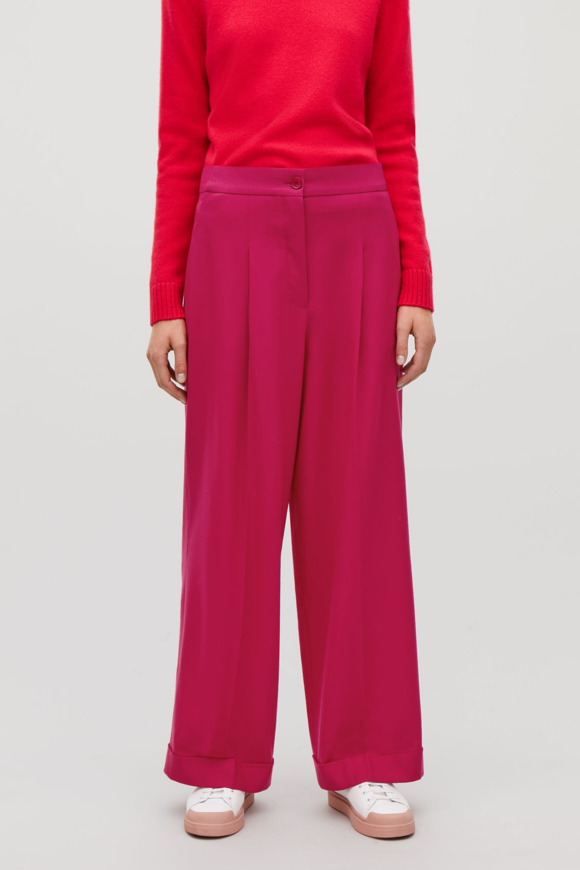 Model side image of Cos turn-up wool trousers in pink
