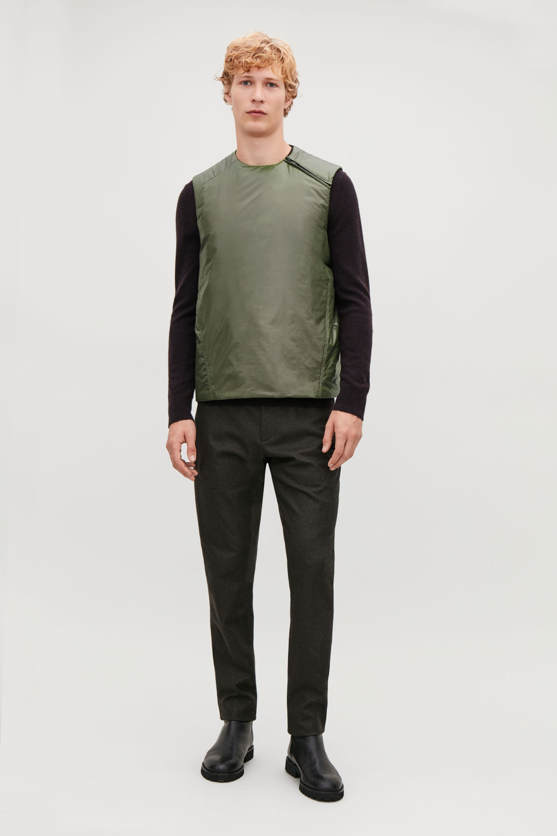 Model side image of Cos padded sleeveless vest in green