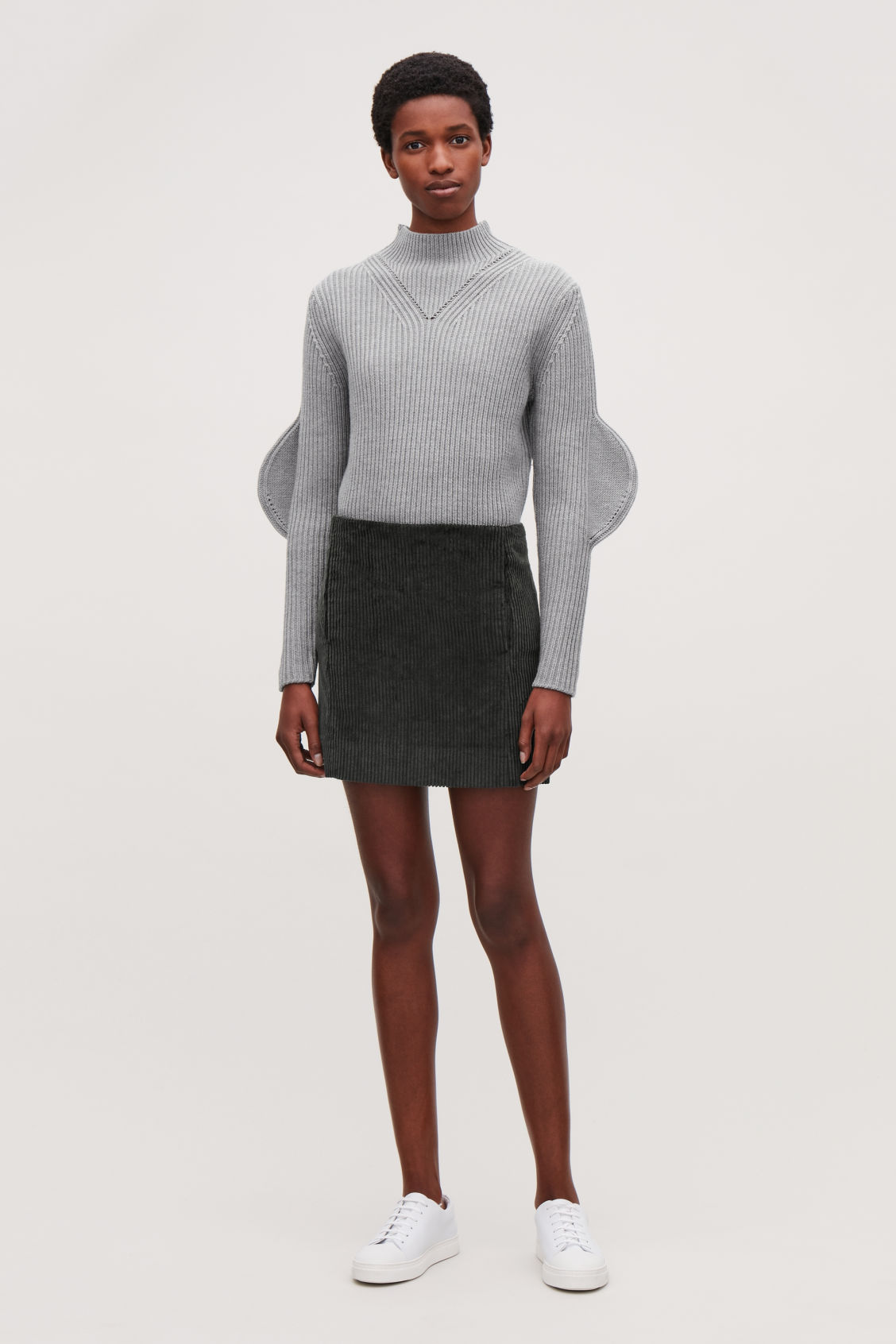 Model front image of Cos short corduroy skirt in grey