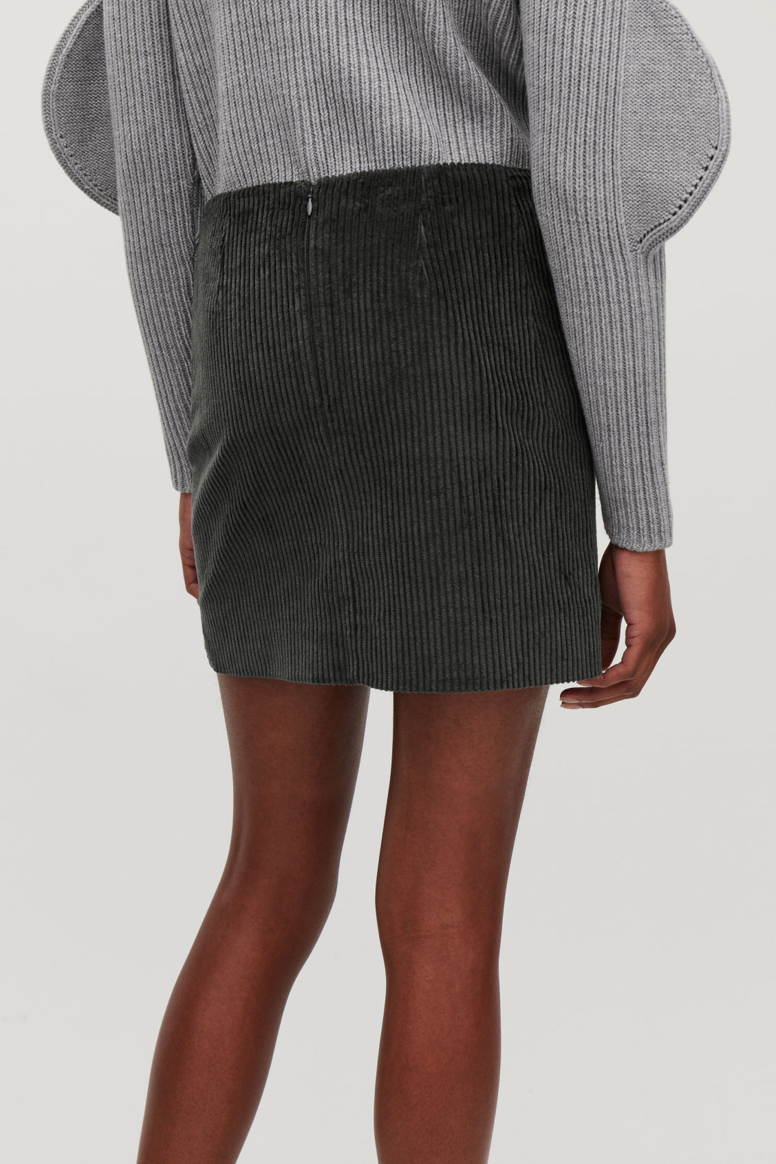 Model side image of Cos short corduroy skirt in grey