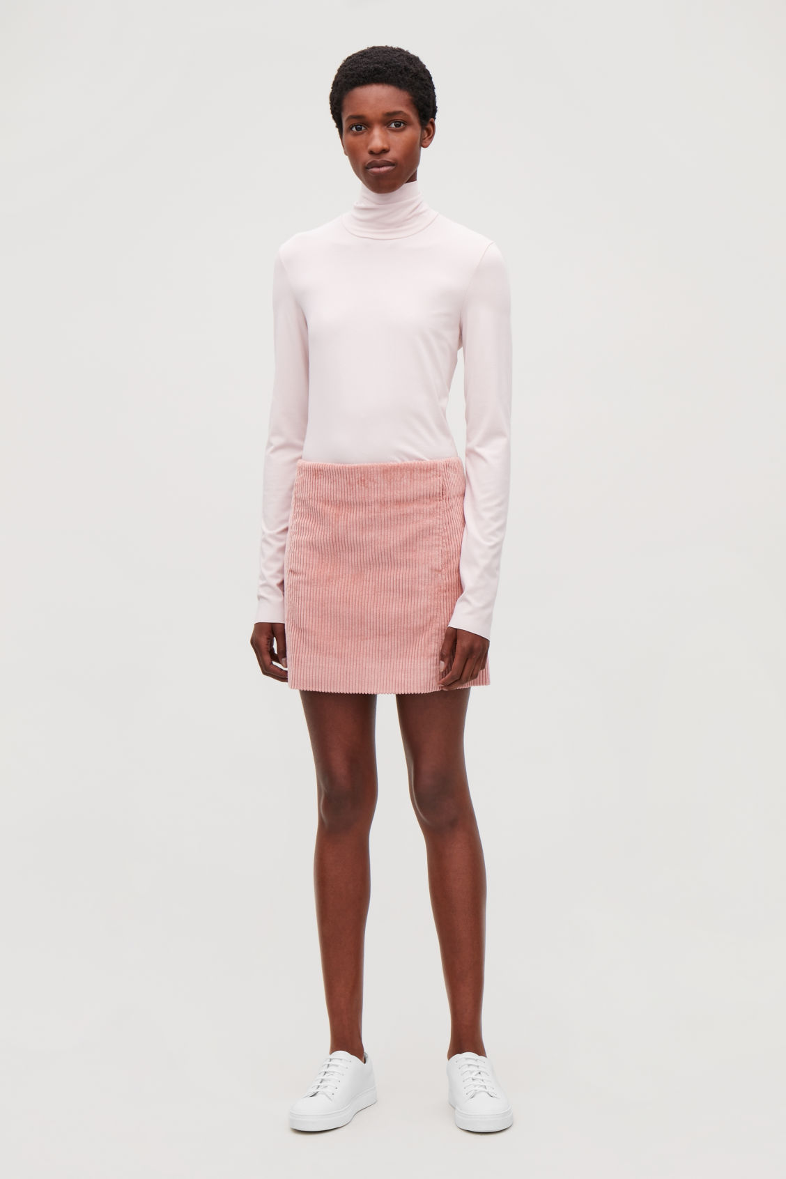 Model front image of Cos short corduroy skirt in pink