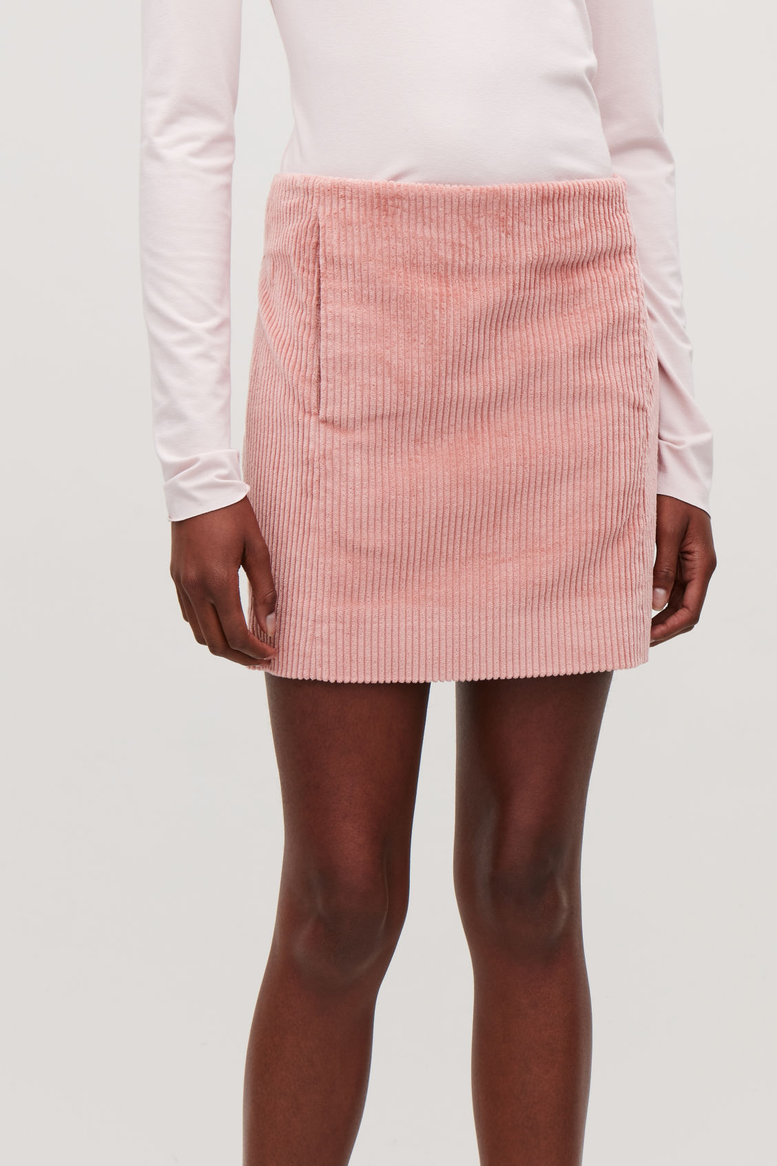 Model side image of Cos short corduroy skirt in pink