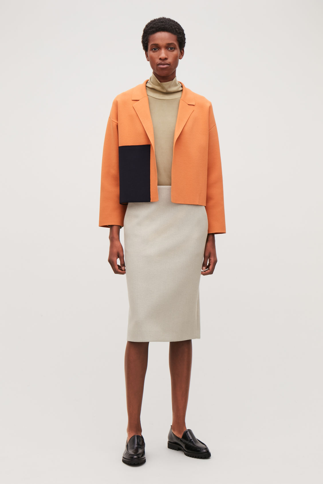 Model front image of Cos knitted jacket with pocket in orange