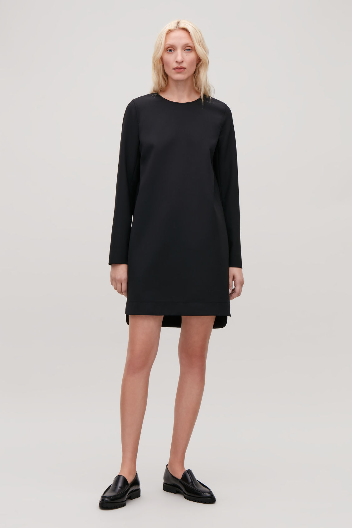 Model front image of Cos short dress with buttoned sleeves in black
