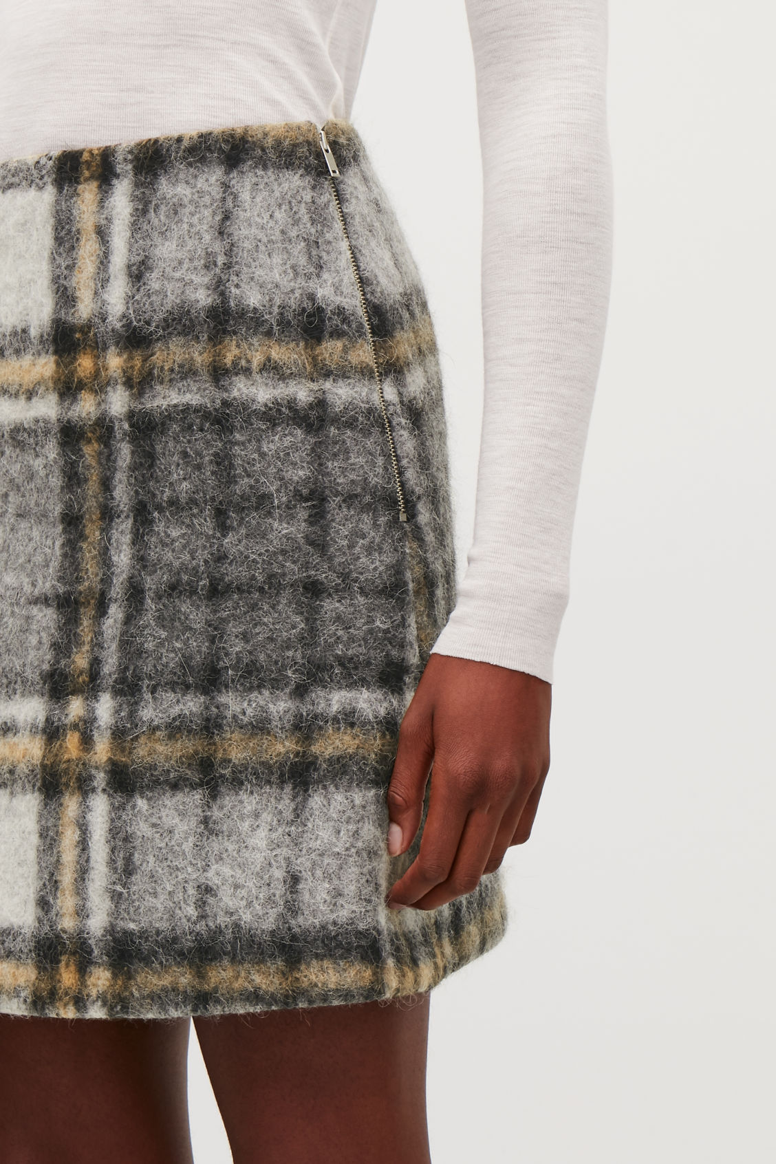 Model side image of Cos checked wool a-line skirt in grey