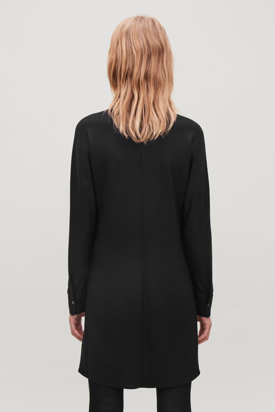 Model side image of Cos wide-sleeve jersey shirt dress in black