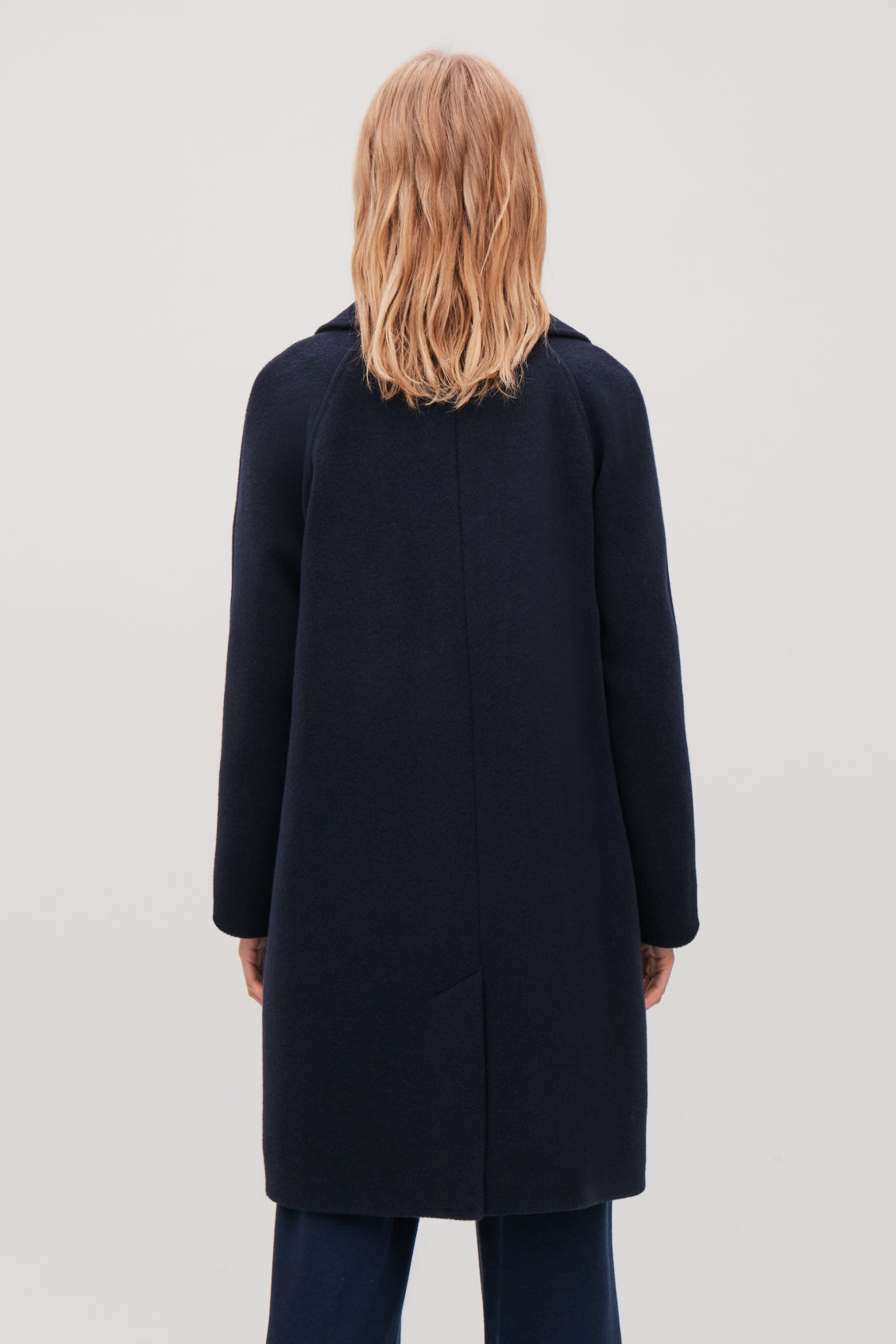 Model side image of Cos long double-breasted coat in blue